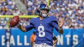 Giants quarterback Daniel Jones #8 scrambles out of