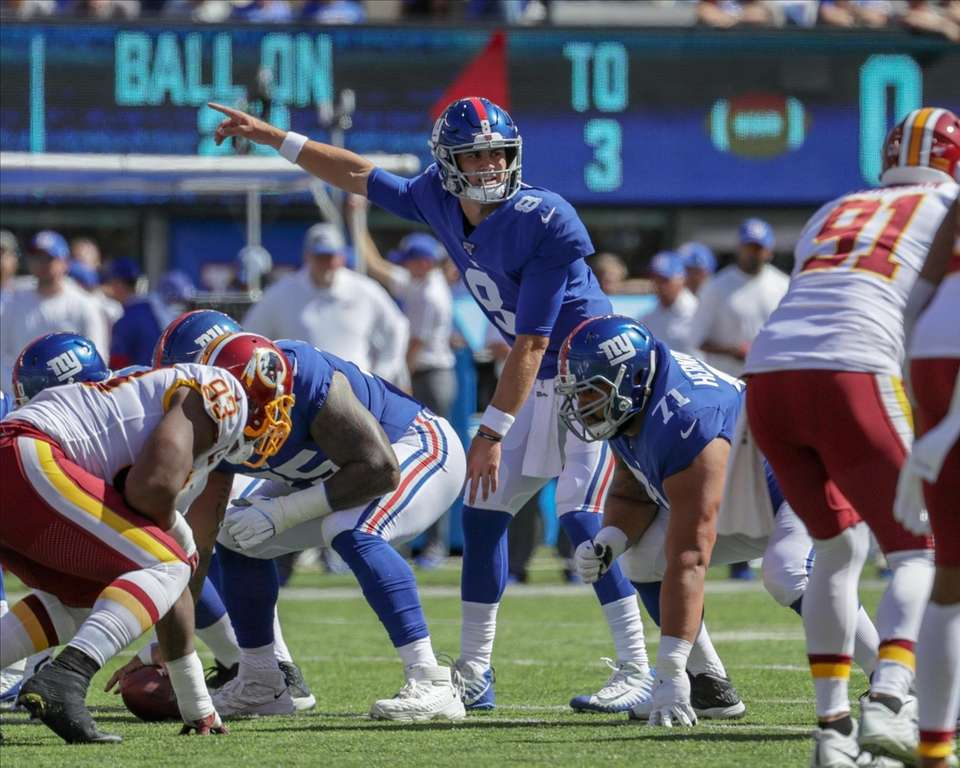 New York Giants quarterback Daniel Jones #8 signals