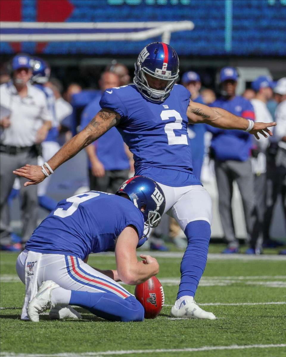 New York Giants kicker Aldrick Rosas #2 hits