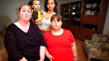 Renee Delgado of Bellport with her children Michael,