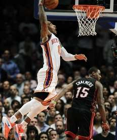 New York Knicks guard J.R. Smith (8) dunks