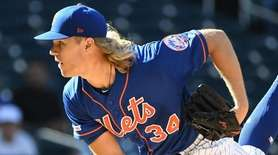 New York Mets starting pitcher Noah Syndergaard follows