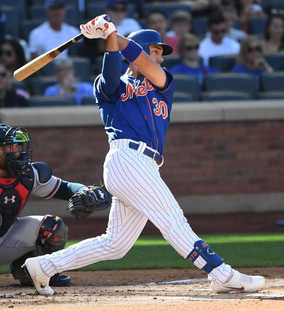 New York Mets' Michael Conforto singles against the
