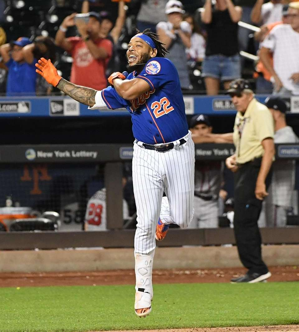 New York Mets' Dominic Smith reacts as he