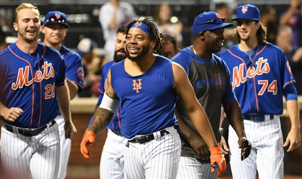 New York Mets' Dominic Smith's celebrates with his