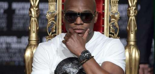 Floyd Mayweather listens during a press conference with