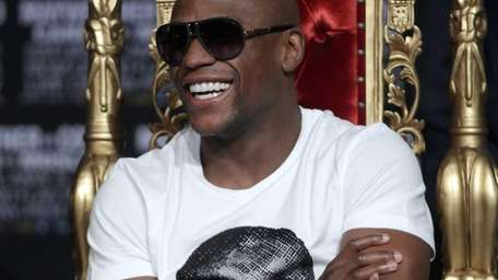 Floyd Mayweather responds to an aquaintance during a