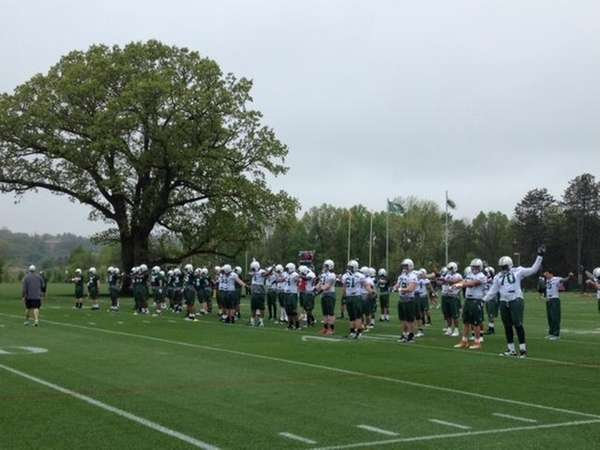 Jets players line up for stretching drills on