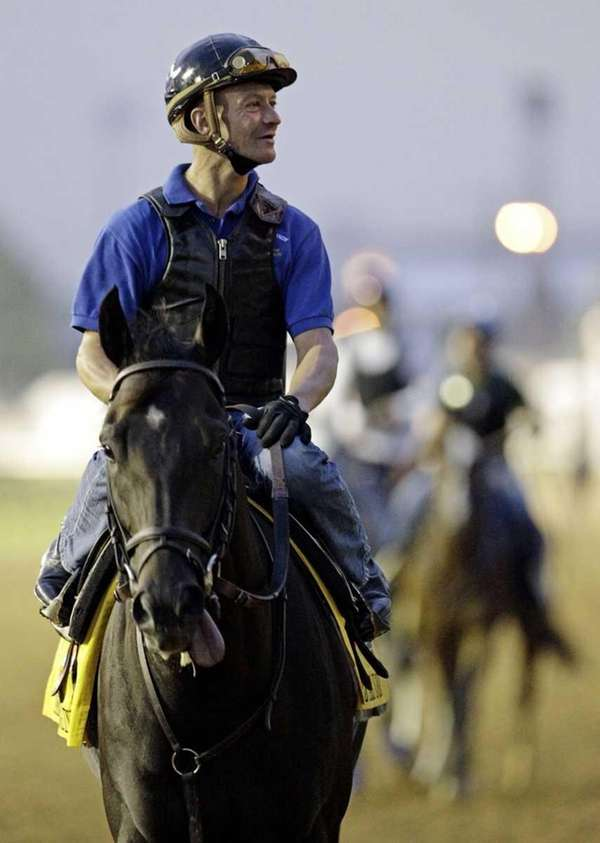 Jockey Calvin Borel rides Kentucky Derby entrant Take
