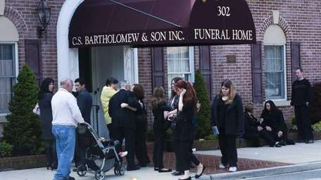Mourners attend the wake and prayer service for