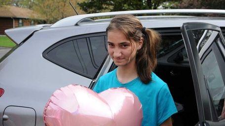 Alana Kiceina, 10, arrives home, after undergoing surgery