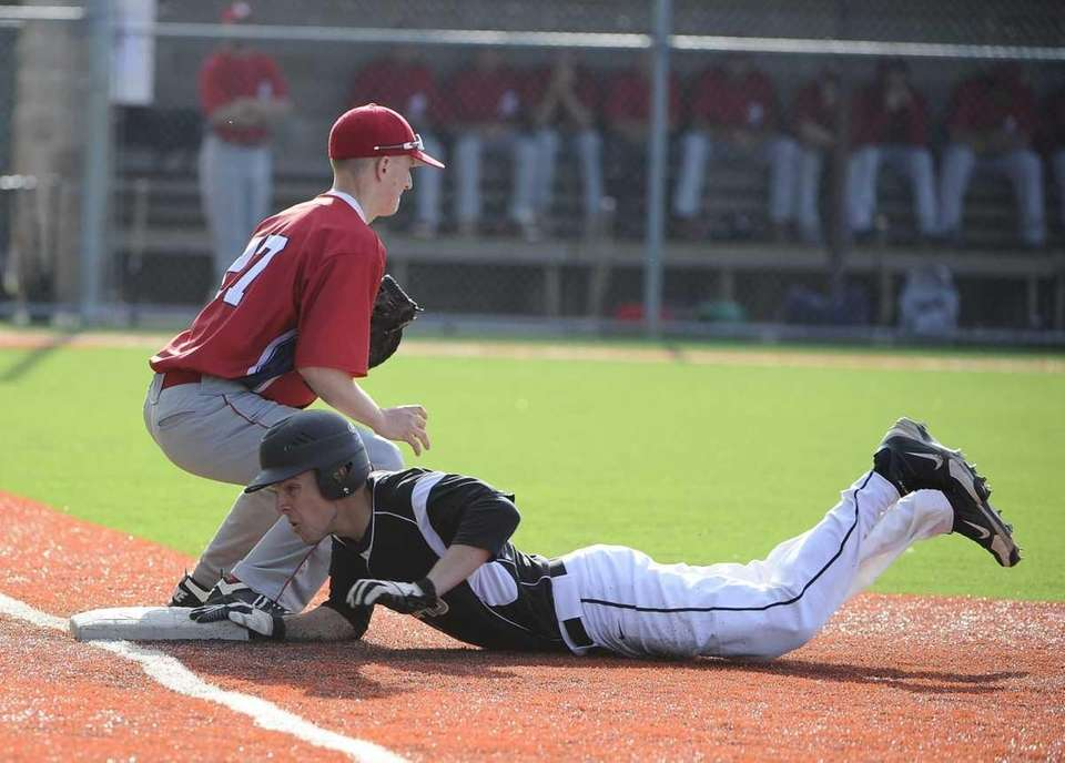 St. Anthony's Paul Britt is safe at first