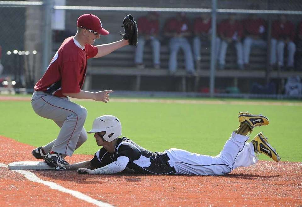 St. Anthony's Matt Costleigh is safe at first