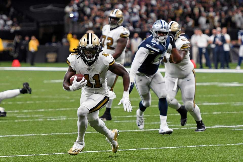 New Orleans Saints running back Alvin Kamara carries