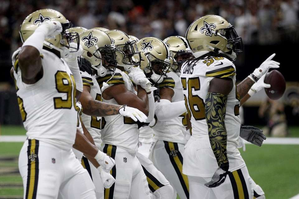 The New Orleans Saints celebrate a play against