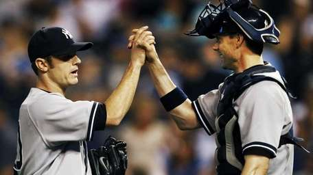 Yankees reliever David Robertson is congratulated by catcher