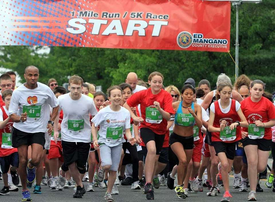 Runners take off for the 1-mile run. The