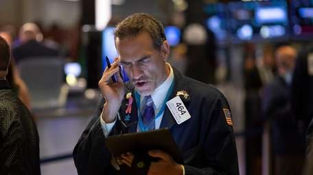 Stock trader Gregory Rowe works at the NYSE