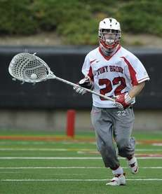 Stony Brook goalkeeper Sean Brady looks to clear