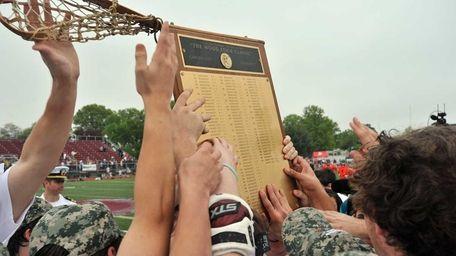 Garden City players hoist the Woodstick Classic trophy