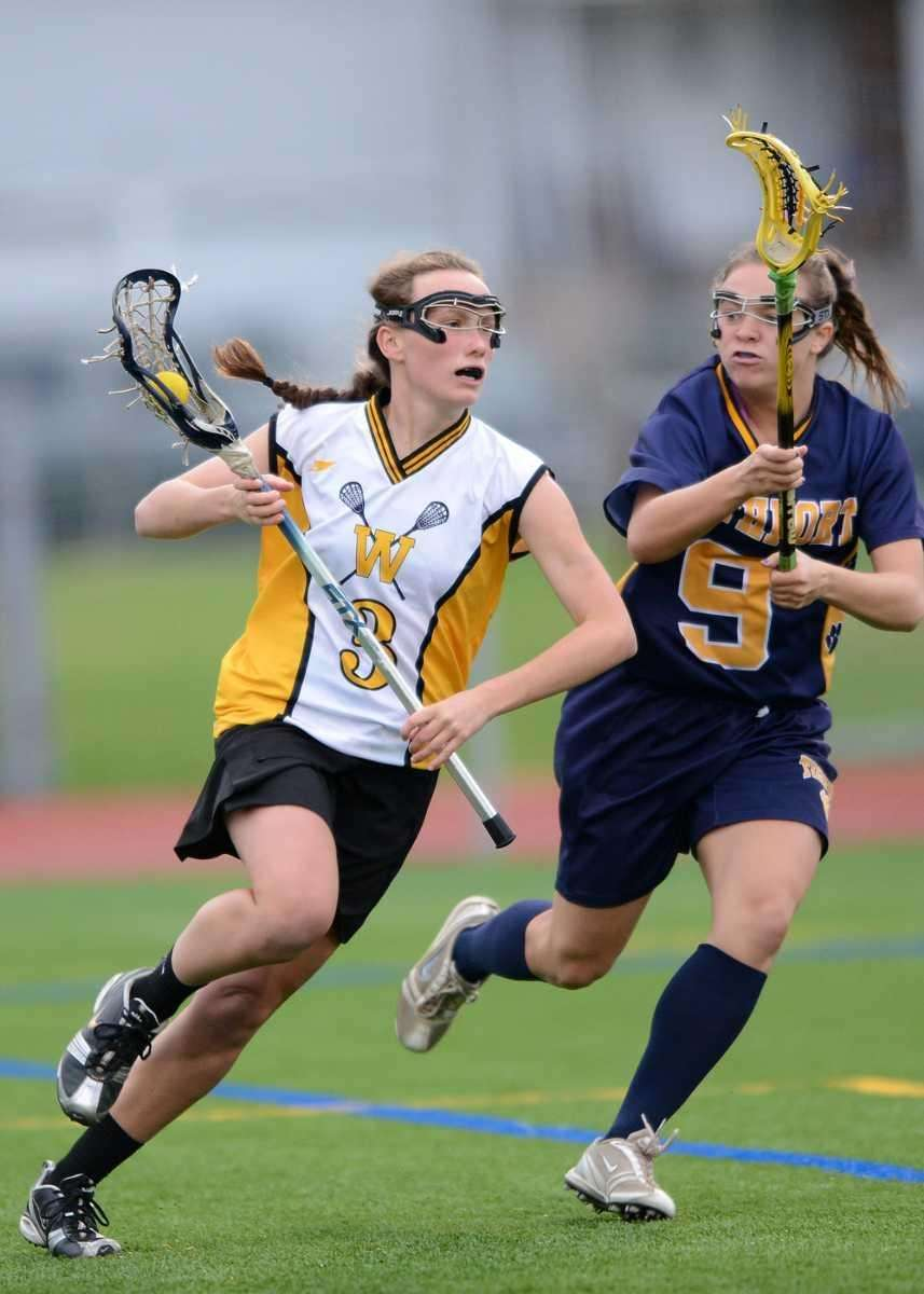 Wantagh's Colleen Lovett (3) drives hard to the