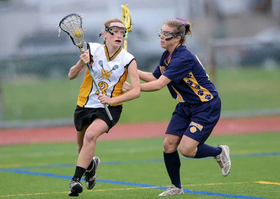 Wantagh's Colleen Lovett (3) drives to the cage