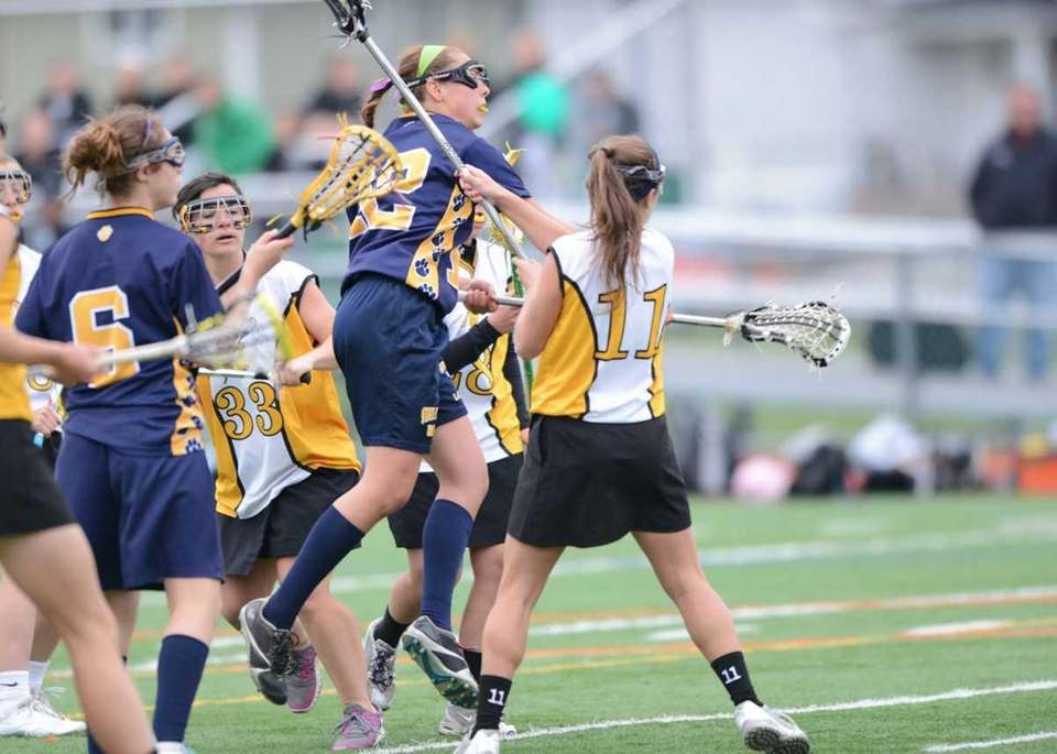 Northport's Dorrien Van Dyke (22) goes over Wantagh's