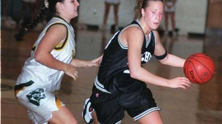 Sachem's Nicole Kaczmarski moves ball around Longwood's Jennifer
