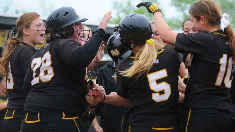 Adelphi University teammates celebrate around Victoria Wink after