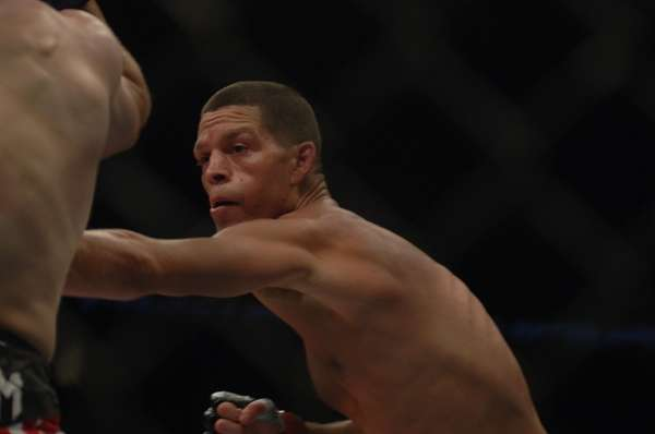 Nate Diaz, right, punches Jim Miller during their