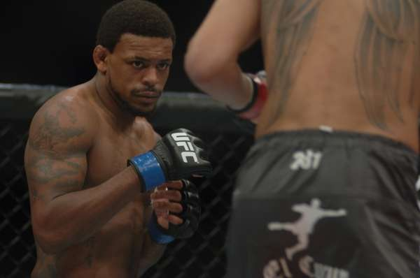 "Michael Johnson, left, beat ""Ultimate Fighter"" Season 13"