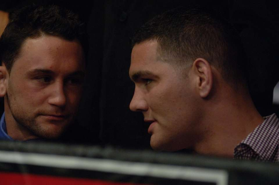 Frankie Edgar, left, and Chris Weidman talk in