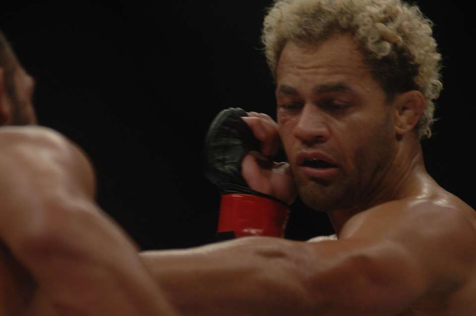 Josh Koscheck throws a punch at Johny Hendricks
