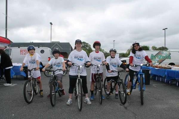 Anna Frangoulis, center, with her bike at the