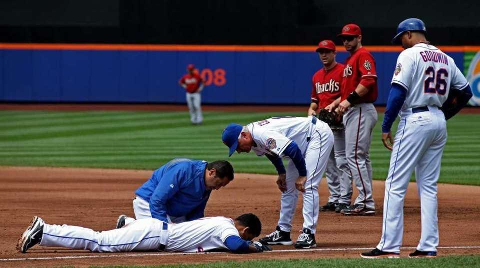 Ruben Tejada is checked out by manager Terry
