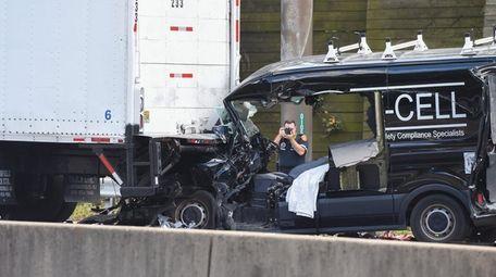 Police investigate the scene of a crash involving