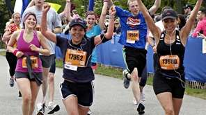 Half marathon runners with visible tags at the