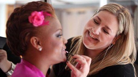 Freelance makeup artist Daniela Baldor, of Larchmont, applies