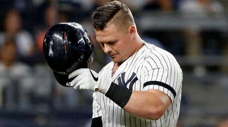Luke Voit strikes out in the ninth inning