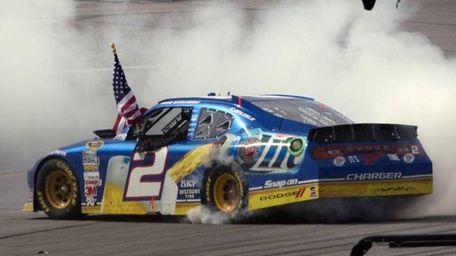 Brad Keselowski performs a burnout after winning the