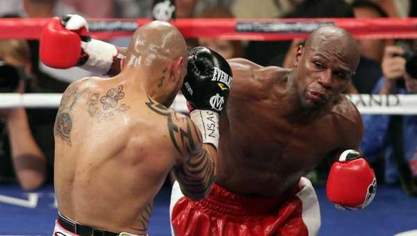 Floyd Mayweather throws a right at the head
