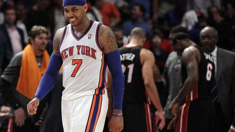New York Knicks' Carmelo Anthony (7) reacts during