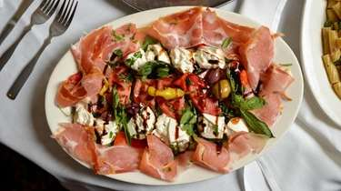 Burrata special with parma prosciutto, roasted peppers, tomato,