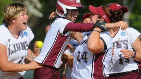 Molloy College centerfielder #3 Jeana Frey, second from