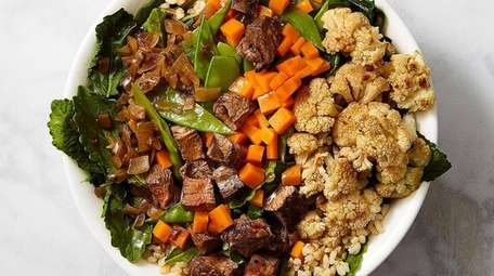 A Lotus bowl of grilled steak, cauliflower, carrots,