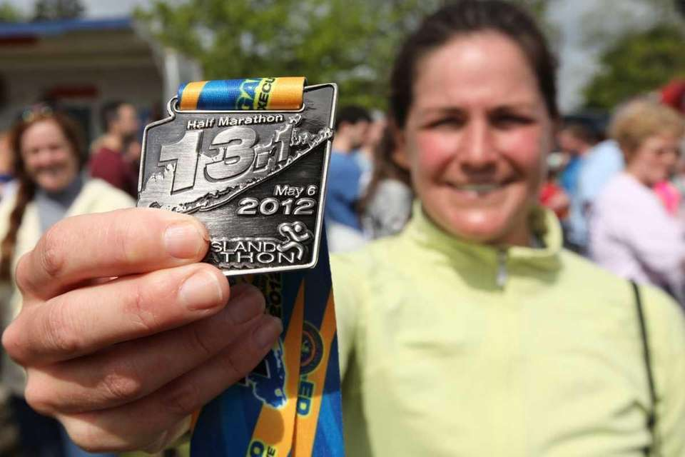 Corinne Maron, of Locust Valley, shows her medal
