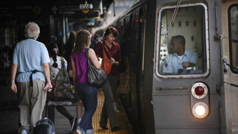 People ride the New York City subway into