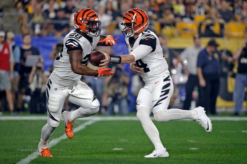 Cincinnati Bengals quarterback Andy Dalton hands off to