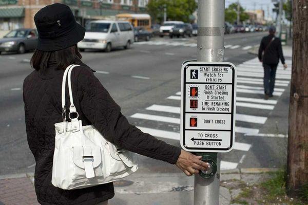 A pedestrian cross Franklin Avenue at Hempstead Turnpike.