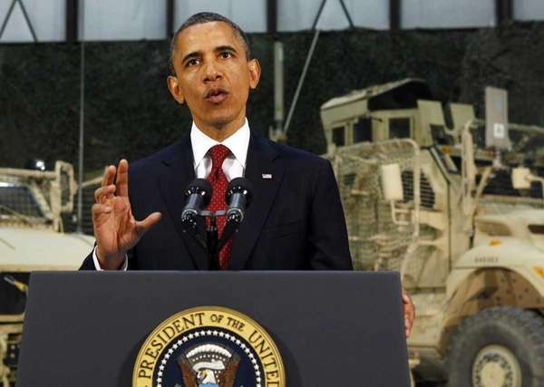 President Barack Obama talks to soldiers at Bagram